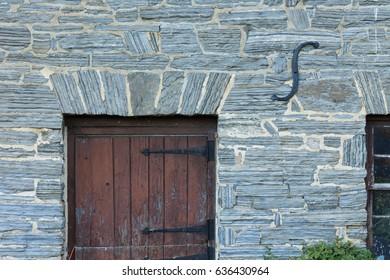 Stone wall, old door