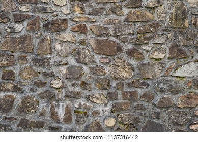 Stone wall of old house building texture pattern cement Quartzite