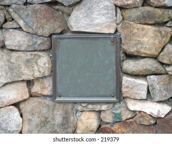 stone wall with old plaque