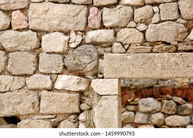 Stone wall ruins in old town Pag, island Pag, Croatia. Selective focus.
