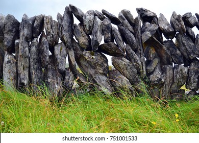 Stone wall, wall of stacked flat stones in Ireland