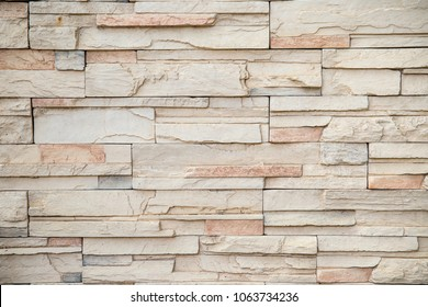 The stone wall texture background natural color.Background of stone wall texture photo.Natural stone wall texture for background.Old Brick texture, Grunge brick wall background.