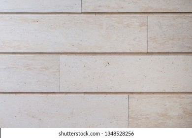 Stone wall texture background with rock pattern closeup