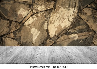 Stone wall texture background surface natural color , process in vintage style with white wood terrace with world map