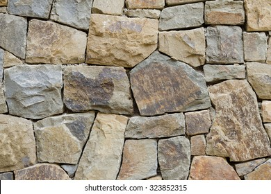 Stone wall texture handmade of rough blocks