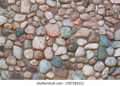 Stone wall texture. Mosaic rocks decorative interior wall background. Masonry wall of old stones