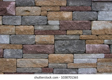Stone wall in three different colors