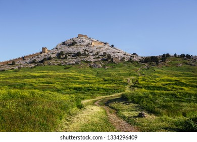 The stone walls of the ancient fortress on blue sky background. Ancient Architecture Of Crimea. Sudak fortress. Crimea. Zander.