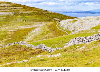 Stone walls in Burren way trail with Galway bay in background, Ballyvaughan, Clare, Ireland