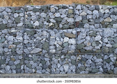 Stone walls prevent landslides in country road