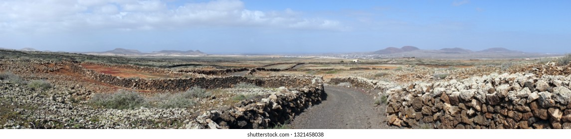 Stone walls and road on the Fuerteventura island, Spain