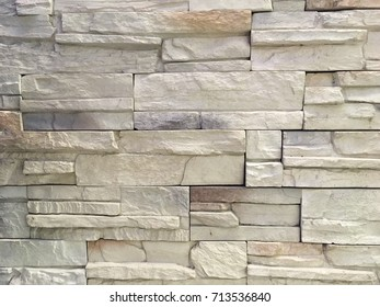 The stone walls are stratified, abstract background texture.