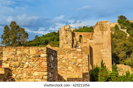 Stone walls and towers of the Alcazaba Fortress in Malaga - Spain, Andalusia.