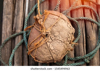 stone which are tied with ropes, anchor, boat buoys, traditional equipment to keep the boat from moving