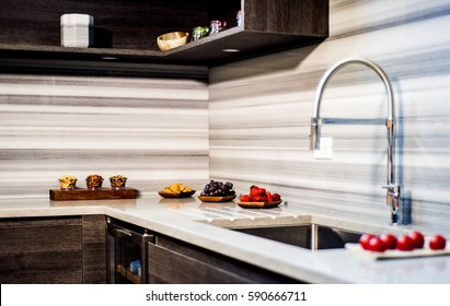stone white worktop with brown cabinetry, granite countertop over modern kitchen cabinets with blue motion without handles