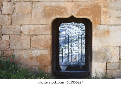 Stone window with Elizabethan arch in castle of the Berlanga de Duero, Soria, Spain,
