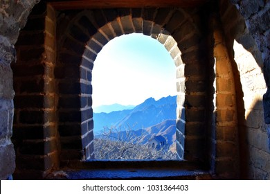 Stone window overlooking the mountain view.