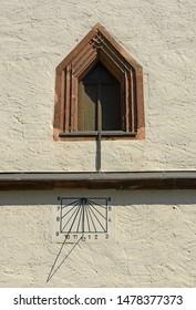 Stone window and sundial – background
