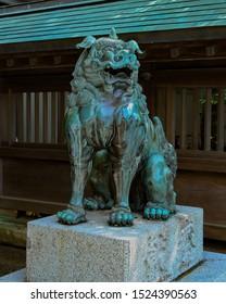 A stone-carved guardian dog Japanese translation: offering