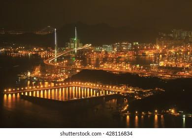 Stonecutter bridge and port of Kowloon at night, Hongkong