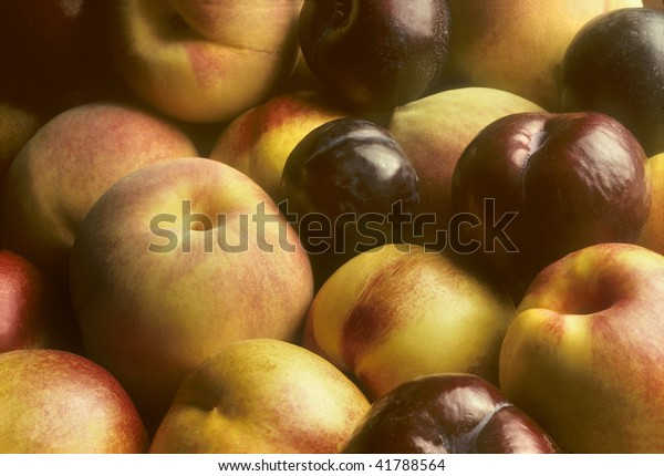 Stonefruit such as plums, nectarines and peaches piled together