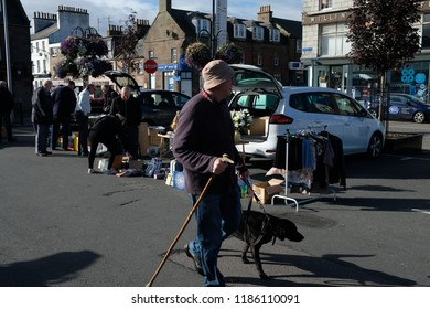 Stonehaven, Scotland - September 23rd 2018: Locals and tourists hunt for bargains at the weekly Sunday carboot sale situated in the town center.