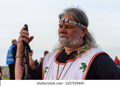 Stonehenge, Amesbury, UK -  June 21st 2018,   Arthur Uther Pendragon neo druid leader facing the sun at the summer solstice at stonehenge