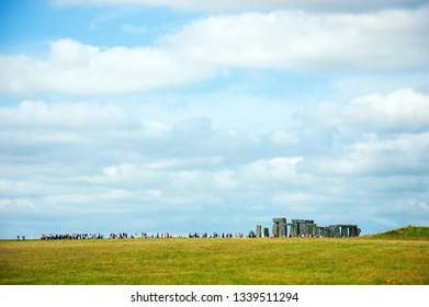 Stonehenge an ancient prehistoric monument in Wiltshire near Salisbury, England, UK. Long line of visitors