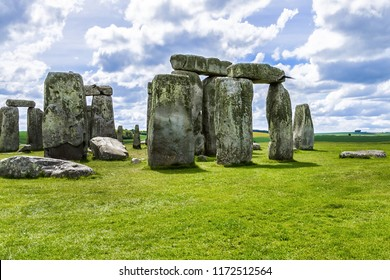 Stonehenge - ancient prehistoric stone monument near Salisbury, Wiltshire, UK. It was built anywhere from 3000 BC to 2000 BC. Sunset. Stonehenge is a UNESCO World Heritage Site in England.