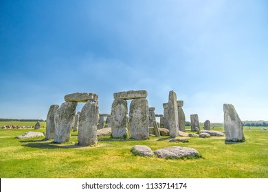 Stonehenge and blue sky an ancient prehistoric stone monument near Salisbury, Wiltshire, UK. Stonehenge is a UNESCO World Heritage Site in England.