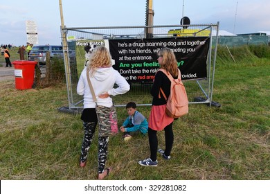 STONEHENGE - JUN 20: Revellers view a narcotics warning notice during celebrations marking the Summer Solstice on Jun 20, 2014 in Stonehenge, UK. Thousands gathered at the ancient historic monument.