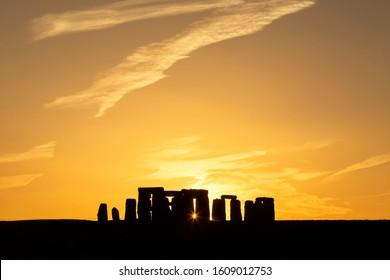 Stonehenge summer solstice sunset with sunburst