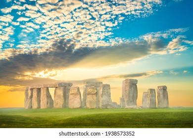 Stonehenge at sunrise with morning mist. England