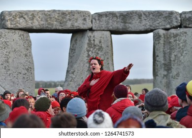 Stonehenge, UK - December 22, 2018: Revellers gather at Stonehenge to celebrate the winter solstice.