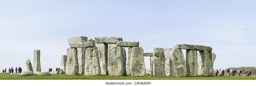 STONEHENGE, WILTSHIRE - APR 11: Tourists amongst the standing stones on Apr 11 2010 in Wiltshire. Construction on the site started in 2600 BC and its purpose remains obscure.