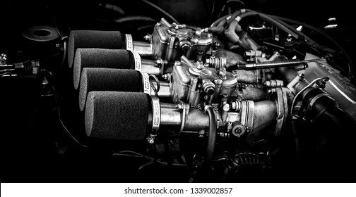 Stoneleigh, Warwickshire / United Kingdom / February 24, 2019: A closeup of the carburettors of a vintage racing car.