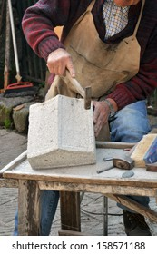 Stonemason. Hands detail of craftsman at work