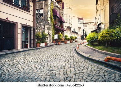 Stone-paved street at sunset. Istanbul, Turkey.