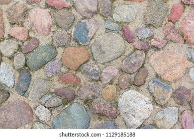 stones are arranged in a chaotic order and are a texture