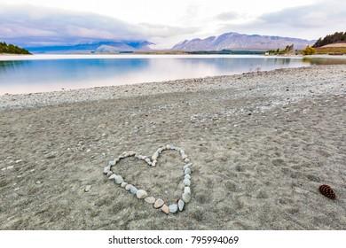 Stones arranged in heart shape on beach