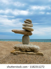 Stones balance on a background of sky and sea
