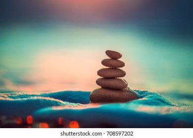 Stones balance on beach, sunrise shot