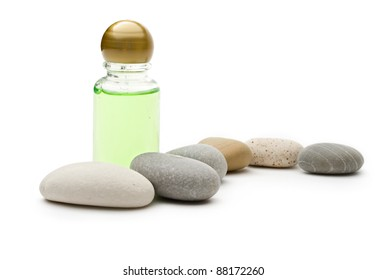 Stones and bottle on the white background