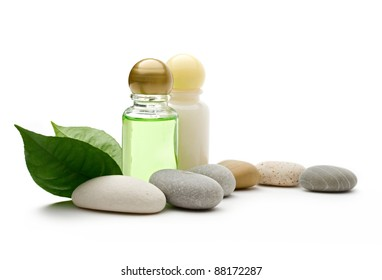 Stones and bottles on the white background