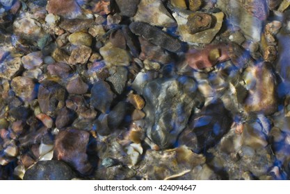 Stones at the bottom of a stream.