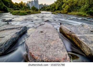 Stones in Bundang River with City in Background