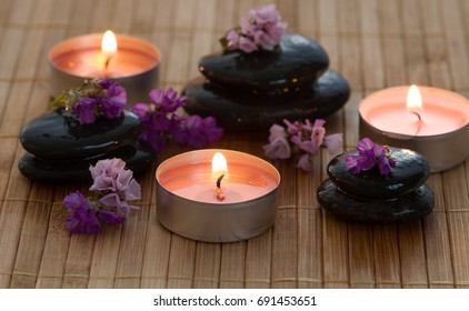 Stones, candles and flowers.Spa concept