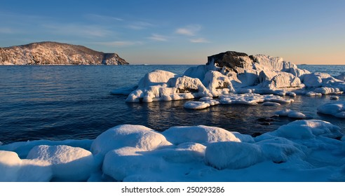 Stones covered with ice on the beach.