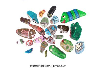 Stones decorated with colorful shapes on white background