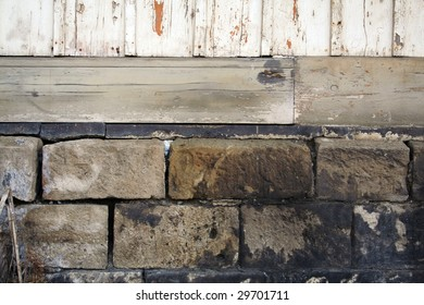 stones and foundation of an old wooden house